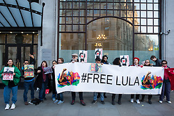 London, UK. 10th April 2019. Activists from the Free Lula International Committee protest outside the Brazilian embassy to demand the release of former President Lula, to denounce his incarceration as a political prisoner, and the mode in which he was replaced by President Bolsonaro and to call on the international community to participate in demonstrations of solidarity with Lula and the Brazilian people.  Credit: Mark Kerrison/Alamy Live News