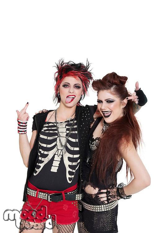 Arrogant punk females showing middle finger over white background