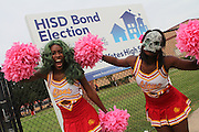 Yates High School cheerleaders dress up like zombies to get into the holiday spirit and promote early voting.<br />