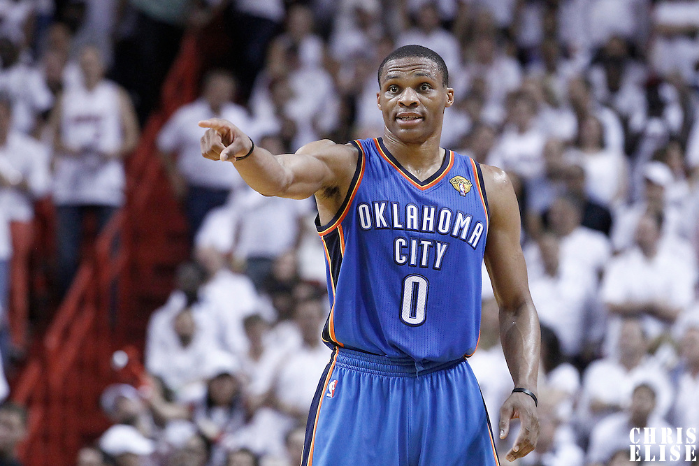 21 June 2012: Oklahoma City Thunder point guard Russell Westbrook (0) talks to a teammate during the second quarter of Game 5 of the 2012 NBA Finals, at the AmericanAirlinesArena, Miami, Florida, USA.