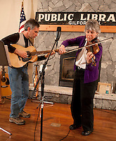 "Fiddler Ellen Carlson accompanied by Tim Mowry on guitar entertains at Gilford Library with a blues song ""Sitting on Top of the World"" followed by jazz, bluegrass and irish selections Thursday evening.    (Karen Bobotas/for the Laconia Daily Sun)"