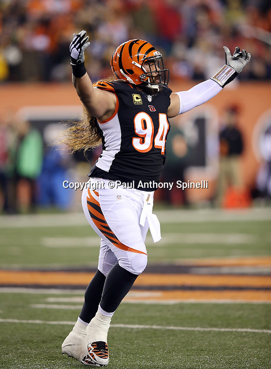 Cincinnati Bengals defensive tackle Domata Peko (94) waves his arms as he runs off the field during the NFL AFC Wild Card playoff football game against the Pittsburgh Steelers on Saturday, Jan. 9, 2016 in Cincinnati. The Steelers won the game 18-16. (©Paul Anthony Spinelli)