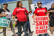 "19 JULY 2012 - PHOENIX, AZ: LETICIA RAMIREZ (center) and NATALLY CRUZ (right) both from Puente, a human rights organization, speak out against Maricopa County Sheriff Joe Arpaio in front of the US Courthouse on the first day of a class action lawsuit, Melendres v. Arpaio in Phoenix Thursday. The suit, brought by the ACLU and MALDEF in federal court against Maricopa County Sheriff Joe Arpaio, alleges a wide spread pattern of racial profiling during Arpaio's ""crime suppression sweeps"" that targeted undocumented immigrants. U.S. District Judge Murray Snow granted the case class action status opening it up to all Latinos stopped by Maricopa County Sheriff's Office deputies during the crime sweeps. The case is being heard in Judge Snow's court.   PHOTO BY JACK KURTZ"