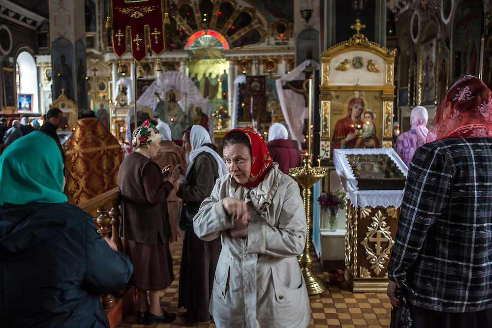 LUHANSK, UKRAINE - MAY 3: An afternoon church service on May 3, 2014 in Lukansk, Ukraine. Cities across Eastern Ukraine have been overtaken by pro-Russian protesters in recent weeks, leading the Ukrainian military to respond with force in some areas. (Photo by Brendan Hoffman for The Washington Post)