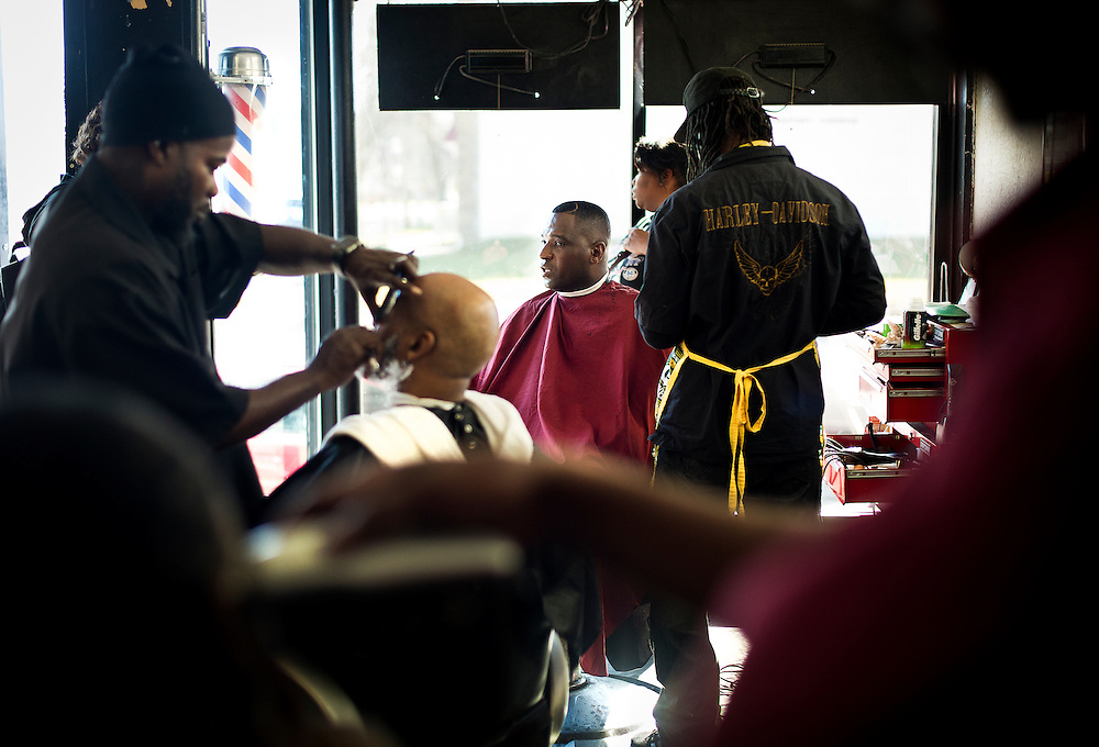 MILWAUKEE, WI - NOVEMBER 17: Justin Babar, center, reflects on the outcome of the 2016 Election at Upper Cutz barbershop on Thursday, November 17, 2016.