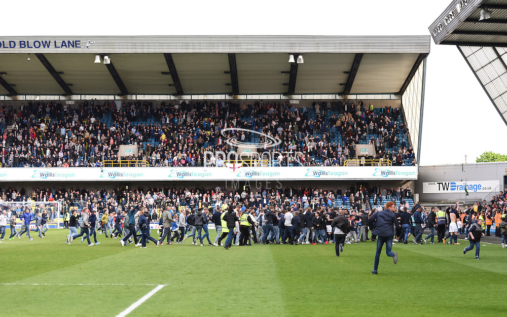 Millwall fans invade the pitch after the Sky Bet Championship match between Millwall and Derby County at The Den, London, England on 25 April 2015. Photo by David Charbit.