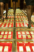 KUNMING, CHINA -  (CHINA OUT) <br /> <br /> 20 Meters Long Gold Walkway<br /> Staff walk on a 20-meter long golden avenue, with 300 pure nuggets valued at nearly 100 million yuan (about 16 million USD), at a store on  Kunming, Yunnan Province of China.<br /> ©ChinaFoto/Exclusivepix