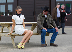 Repro Free: 23/04/2013 Model Roz Purcell is pictured with cowboy Bill Knispel, Quater Horse dealer from Califonia at the opening day of the Punchestown 2012 racing festival where she was guest judge for the Coast best dressed lady. Picture Andres Poveda