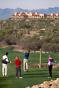 Foursome teeing off, Canyon hole #4. Santa Catalina Mountains in the background, Westin La Paloma. ©1993Edward McCain. All rights reserved. McCain Photography, McCain Creative.