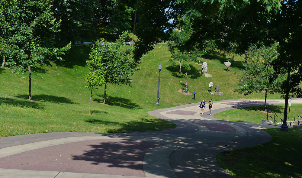 Two students walk along the University Esplanade during Destination Kent State.