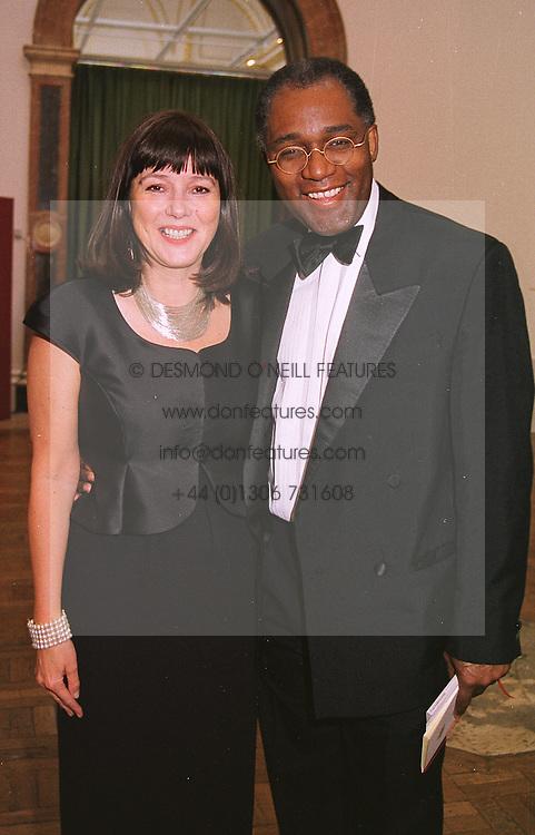 MISS BELINDA HARLEY and broadcaster MR TREVOR PHILLIPS, at a dinner in London on 1st June 1999.MSR 73A