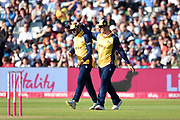 Simon Harmer of Essex Eagles congratulates Aron Nijjar on taking the catch to dismiss Ravi Rampaul during the Vitality T20 Finals Day 2019 match between Derbyshire Falcons and Essex Eagles at Edgbaston, Birmingham, United Kingdom on 21 September 2019.
