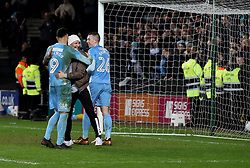 Coventry City's Maxime Biamou and Jordan Shipley celebrate with a fan after the final whistle of the Emirates FA Cup  Fourth Round match at  Stadium MK Milton Keynes.