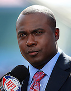 TAMPA, FL - JANUARY 27: NFL Network commentator Marshall Faulk works on air as the AFC Pittsburgh Steelers speak to the media during Super Bowl XLIII Media Day at Raymond James Stadium on January 27, 2009 in Tampa, Florida. ©Paul Anthony Spinelli *** Local Caption *** Marshall Faulk