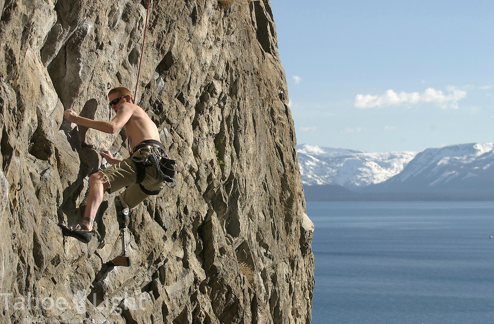 Climber Brent Kuemmerle, who lost his right leg in a car accident in 1995, climbs up the wall of Cave Rock just north of South Lake Tahoe, NV, Monday evening May 12, 2003. This rock, long prized by climbers for its challenging routes and easy access is also a sacred spot for the local  Washoe tribes of northern Nevada. American Indian doctors would go to a place called ?De ek wa dep push? to meditate, this was thier name for Cave Rock Recently a temporary agreement was reached allowing climbers to use existing routes, but install no new ones.