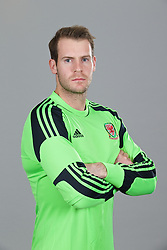 CARDIFF, WALES - Thursday, November 14, 2013: Wales' goalkeeper Owain Fon Williams wearing the new Wales 2013/2014 Adidas home jersey. (Pic by David Rawcliffe/Propaganda)