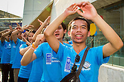 09 DECEMBER 2012 - BANGKOK, THAILAND:  Thai college students participate in an anti-corruption program at the Bangkok Art and Culture Centre (BACC). About 1,500 Thai university students from 90 universities across Thailand attended the rally. The latest Corruption Perceptions Index survey by Transparency International listed Thailand at number 88 out of 176 countries surveyed. The level of corruption in Thailand is perceived to be on the same par as Malawi, Swaziland and Zambia. Thailand's ranking slipped from 80 last year. A series of surveys show that Thais increasingly view corruption as acceptable. A recent ABAC (Assumption Business Administration College, the forerunner to Assumption University, one of the most respected private universities in Thailand) poll reported that a majority (63 per cent) of Thai people hold the view that corruption in government is acceptable as long as they also benefit from it. A majority of young people under 20 now hold the same attitude. International Anti-Corruption Day has been observed annually, on the 9th December, since the passage of the United Nations Convention Against Corruption on 31 October 2003.       PHOTO BY JACK KURTZ