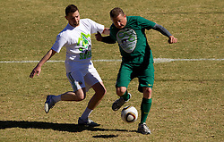 Jernej Suhadolnik vs Danilo Steyer during friendly match between Slovenian football journalists and officials of Slovenian football federation at  Hyde Park High School Stadium on June 16, 2010 in Johannesburg, South Africa.  (Photo by Vid Ponikvar / Sportida)