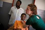 (Nohana, Lesotho - February 4, 2008) With the help of Mission Aviation Fellows, Doctor Jen Furin of Partners in Health visits a rural health clinic in Nohana, an 8.5 hour drive from the capital Maseu.  Doctor Furin admits a 30 year old woman suffering from AIDS, TB and meningitis. .Staff Photo Justin Ide/Harvard University News Office