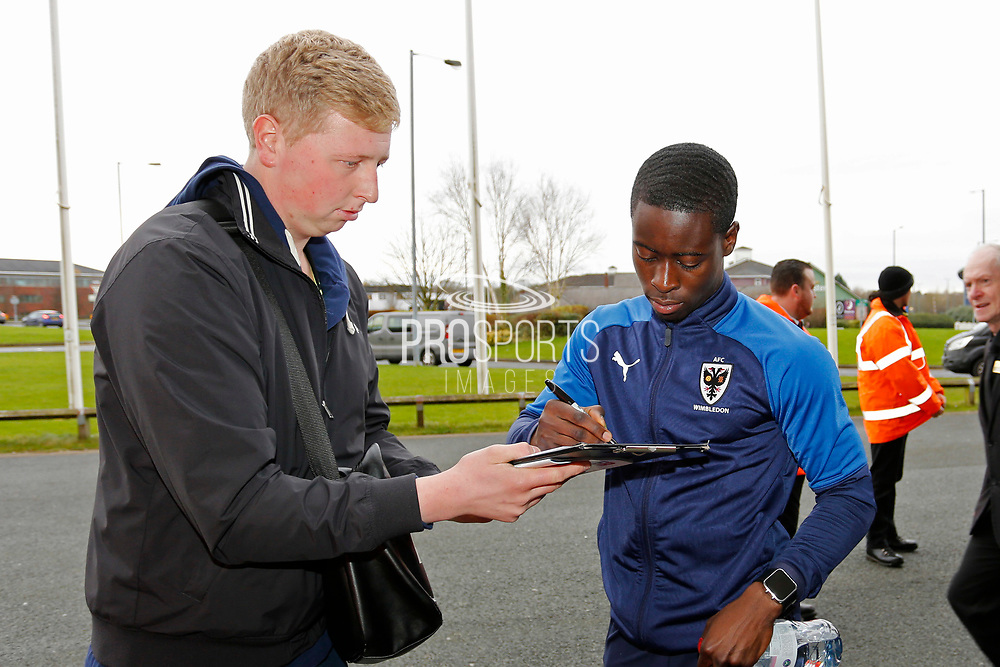 Paul Osew of Wimbledon signing an autograph during the EFL Sky Bet League 1 match between Bolton Wanderers and AFC Wimbledon at the University of  Bolton Stadium, Bolton, England on 7 December 2019.