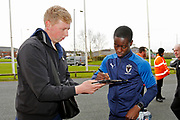 Paul Osew of Wimbledon signing an autograph during the EFL Sky Bet League 1 match between Bolton Wanderers and AFC Wimbledon at the University of  Bolton Stadium, Bolton, England on 7 December 2019.