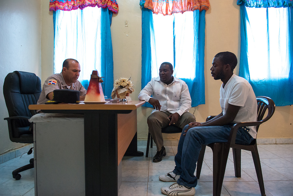 Immigration lawyer Doctor Mario Jacobs (center) accompanies police brutality victim Manuel Silla to police headquarters in Hato Mayor to file a complaint against the officer who shot Silla with a pellet gun. Doctor Jacobs says racial discrimination and brutality against Haitians is common in the DR.