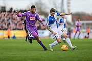 Bristol Rovers James Clarke and Plymouth Argyle's Reuben Reid during the Sky Bet League 2 match between Bristol Rovers and Plymouth Argyle at the Memorial Stadium, Bristol, England on 23 January 2016. Photo by Shane Healey.