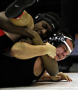 David Jones of Bryan High School, top, grabs a hold of New Braunfels Canyon High School's Nick Mabry during the boys' finals of the Region IV wrestling tournament at Littleton Gymnasium on Saturday, Feb. 11, 2012. Jones won the bout to become 220 lb. champion.
