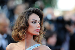 Romanian model Madalina Ghenea arrives for the screening of 'Lawless' presented in competition at the 65th Cannes film festival on May 19, 2012 in Cannes. Photo Ki Price/i-Images
