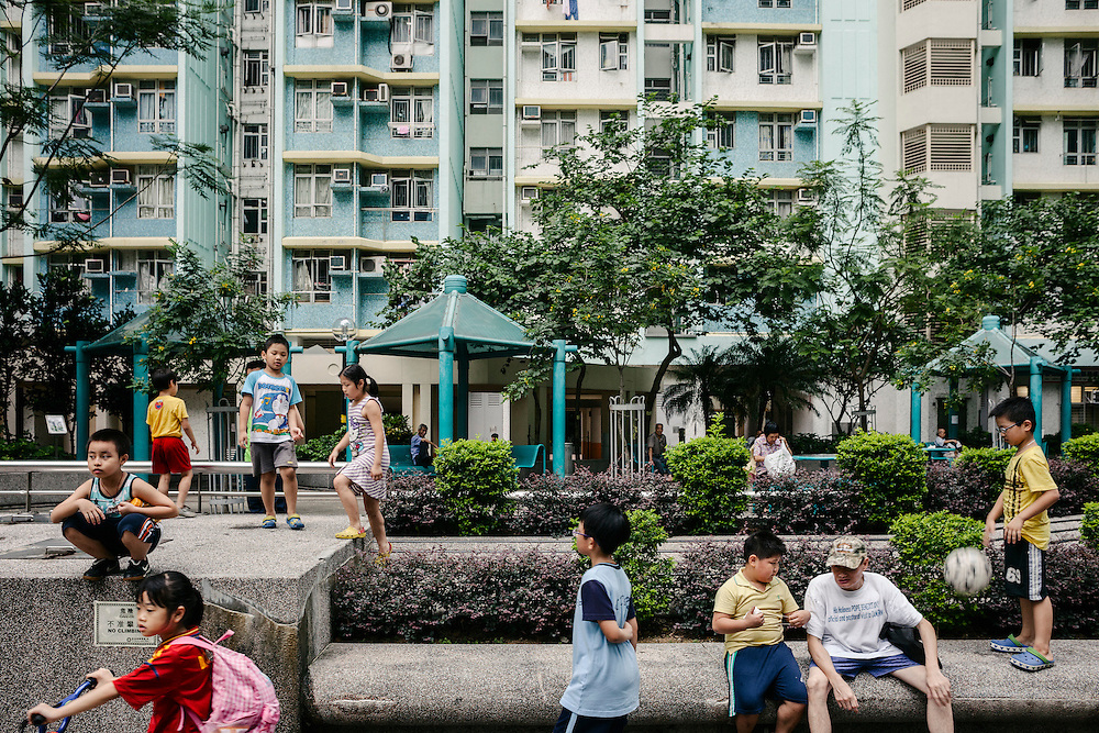 People at a highrise residential area in the city.