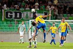 Nikola Nikezic #18 of Olimpija and Marko Krajcer #5 of Celje during football match between NK Olimpija and NK Celje in 6th Round of Prva liga NZS 2012/13, on August 18, 2012 in SRC Stozice, Slovenia. (Photo by Urban Urbanc / Sportida.com)