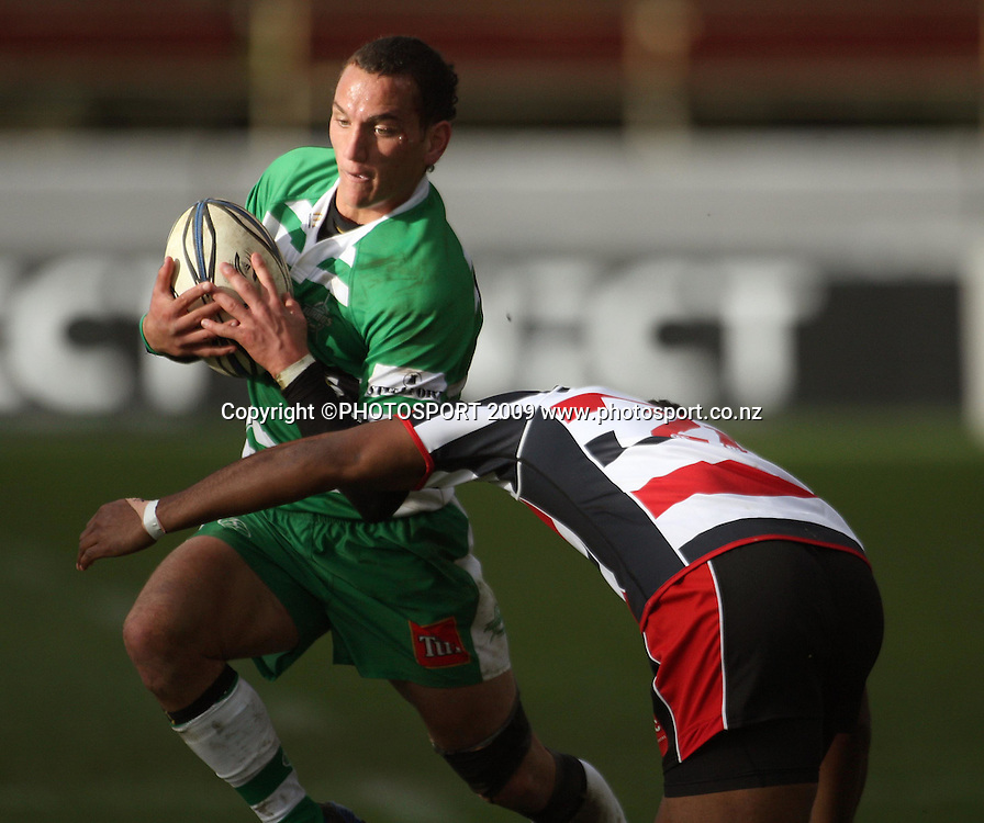 Manawatu first five Aaron Cruden tries to beat Seremaia Tagicakibau.<br /> Air NZ Cup rugby - Manawatu Turbos v Counties-Manukau Steelers at FMG Stadium, Palmerston North, New Zealand, Sunday, 2 August 2009. Photo: Dave Lintott/PHOTOSPORT