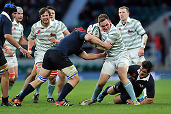 Sam Allen of Cambridge University is tackled in possession - Photo mandatory by-line: Patrick Khachfe/JMP - Mobile: 07966 386802 11/12/2014 - SPORT - RUGBY UNION - London - Twickenham Stadium - Oxford University v Cambridge University - The Varsity Match