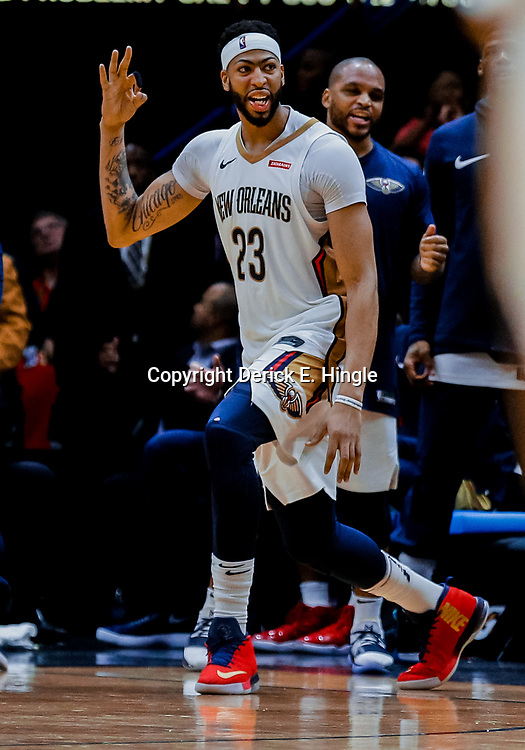 Jan 22, 2018; New Orleans, LA, USA; New Orleans Pelicans forward Anthony Davis (23) celebrates after a three point basket by center DeMarcus Cousins (not pictured) during double overtime against the Chicago Bulls at the Smoothie King Center. The Pelicans defeated the Bulls 132-128 in double overtime. Mandatory Credit: Derick E. Hingle-USA TODAY Sports