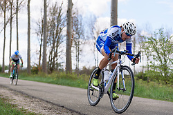 Fighting to stay in touch through the crosswinds at Omloop van Borsele 2016. A 139 km road race starting and finishing in 's-Heerenhoek, Netherlands on 23rd April 2016.