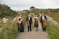 Galway Ensemble in Residence - ConTempo.On the way to the islands - - with Haydn & Mendelssohn!..The Galway Ensemble in Residence - Con Tempo, set off this morning for  Inis Oírr where they will begin their first ever County Galway tour, bringing the music of Haydn and Mendelssohn to the people of Galway in celebration of both composers whose bi-centenaries occurred this year. ..Pictured enroute to the Ferry at Rossaveal are:  Andreea Banciu, viola  Bogdan Sofei, violin, Ingrid Nicola, violin and Adrian Mantu, 'cello..The tour will continue over the weekend in various venues throughout the county before the grand finale in St. Nicholas Church with classical guitarist John Feeley on Sunday night. Photo : Andrew Downes. Photo issued with compliments, no reproduction fee...Tickets for all concerts will be available at the door. Check your local venue for more information or log on to www.galwayensemble.ie.