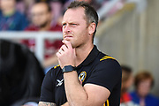 Newport County manager Mike Flynn  looks concerned during the EFL Sky Bet League 2 match between Northampton Town and Newport County at the PTS Academy Stadium, Northampton, England on 14 September 2019.