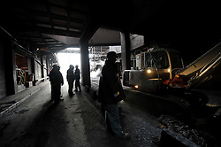 Arcelor-Mittal employees work at the Ougree facility near Liege, Belgium, Monday, Feb. 9, 2009. (Photo © Jock Fistick)