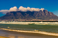 View of Cape Town and Table Mountain and Lion's Head Peak from the beach at Milnerton, South Africa.