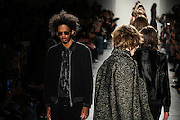 Brandon Bailey walks the runway wearing Custo Barcelona Fall 2016 20th Anniversary Collection during New York Fashion Week on February 14, 2016