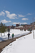 Joggers on a cleared path in downtown Marquette Michigan in winter.