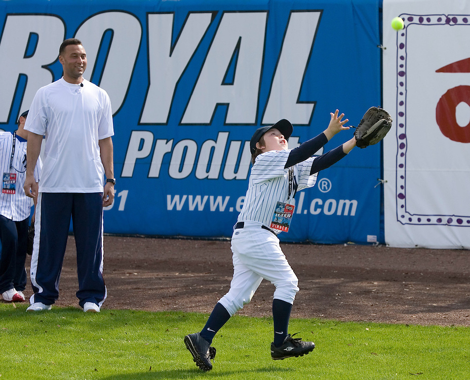 "Bryce Porter fields a ball under the watchful eye of the New York Yankee's Derek Jeter (L)  during the Upper Deck, ""Play Ball! with Derek Jeter"" clinic on Saturday, February 10, 2007 at Legends Field in Tampa, Florida.   Justin Topa, 15, of Binghampton, New York, Jordan Boone, 10, of Las Vegas, Nevada, Bryce Porter, 10, of Costa Mesa, California and Gavin Leonard, 9, of Bristol, Virginia, each won the grand prize to meet Jeter through various promotions on www.UpperDeckKids.com in 2006 .UPPER DECK/Scott Audette"
