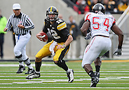 October 03, 2009: Iowa quarterback Ricky Stanzi (12) tries to avoid Arkansas State defensive end Stanley Wakwe (54) during the first half of the Iowa Hawkeyes' 24-21 win over the Arkansas State Red Wolves at Kinnick Stadium in Iowa City, Iowa on October 03, 2009.