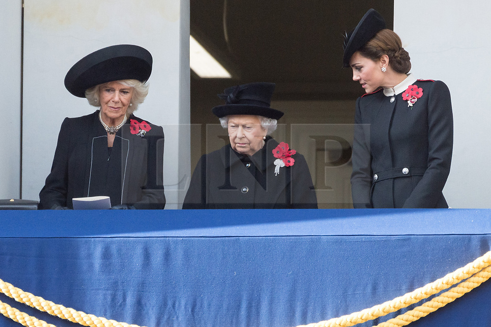 © Licensed to London News Pictures. 11/11/2018. London, UK.  The Duchess of Cornwall, Queen Elizabeth II and The Duchess of Cambridg attends a Remembrance Day Ceremony at the Cenotaph war memorial in London, United Kingdom, on November 11, 2018.  Thousands of people honour the war dead by gathering at the iconic memorial to lay wreaths and observe two minutes silence and marks the 100th anniversary of Armistice Day. Photo credit: Ray Tang/LNP