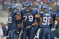 06 November 2011: Defensive linemen (92) Brandon Mebane and (79) Red Bryant of the Seattle Seahawks prepare to line up against the Dallas Cowboys during the first half of the Cowboys 23-13 victory over the Seahawks at Cowboy Stadium in Arlington, TX.