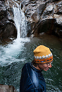 Friends enjoy an early morning excursion to the waterfalls near Mineral Creek Campground, outside of Silverton, Colorado.