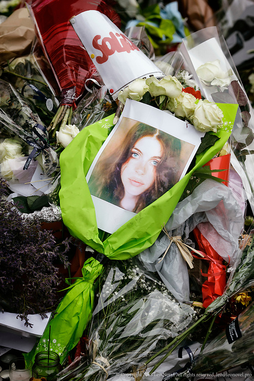 16  November  2015 – Paris, France A photo of an alleged victim is seen as mourners lay flowers and light candles next to Bataclan concert venue in central Paris.  In a series of acts of violence, some 129 people were killing in shootings and suicide bombing. ISIL or islamic state claimed the responsibility.