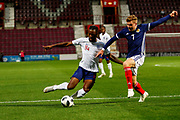 Joshua Onomah England U21s (Sheffield Wednesday, loan from Tottenham Hotspur) challenges for the ball against Chris Cadden Scotland U21s (Motherwell FC) during the U21 UEFA EUROPEAN CHAMPIONSHIPS match Scotland vs England at Tynecastle Stadium, Edinburgh, Scotland, Tuesday 16 October 2018.