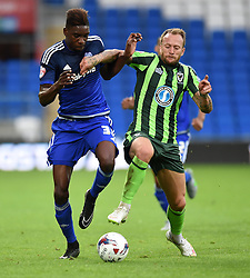 Sammy Ameobi of Cardiff City tussles with Sean Rigg of AFC Wimbledon - Mandatory by-line: Paul Knight/JMP - Mobile: 07966 386802 - 11/08/2015 -  FOOTBALL - Cardiff City Stadium - Cardiff, Wales -  Cardiff City v AFC Wimbledon - Capital One Cup