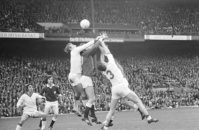 Galway's M Rooney fails to hold the ball as he is challenged by three Cork players during the All Ireland Senior Gaelic Football Championship Final Cork v Galway in Croke Park on the 23rd September 1973. Cork 3-17 Galway 2-13.